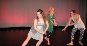 Katy Gaines, Angie Bogner and Sasha Mrozinski are among about 30 dancers performing this weekend in the annual Community Dance Concert at the Foundry Theater on the Antioch College campus. Here they rehearse at the theater while Foundry technicians set lighting for the show. Performances will be 7 p.m. Friday and Saturday, Feb. 26 and 27. Tickets are $10 at the door. (Photo by Carol Simmons)