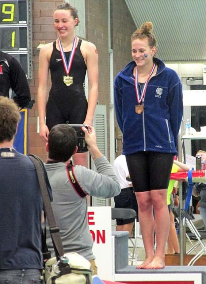 Bulldog swimmer Olivia Chick beamed proudly after receiving a bronze medal for her impressive finish in the 100 freestyle in the State Swimming Championship, held in Canton on Feb. 25 and 26. Chick and fellow Bulldog Aman Ngqakayi represented the school (and village) in the tournament, setting both school and personal records in the process. (Submitted Photo)