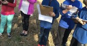 Mr. Knostman's fourth-grade class at Mills Lawn School is working on a project to improve the Glen Forest cemetery by adding a memory bench. Students here are shown mapping the project. (Submitted Photo)