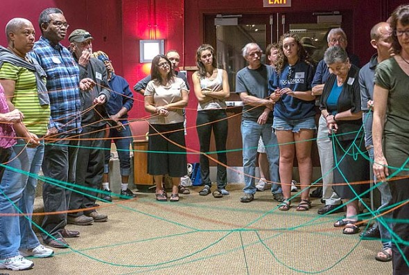 "This month's focus on local economy includes discussions of time exchanges, cooperative food hubs, local investing and more. Here, participants in a yarn game at Community Solutions' fall 2015 conference discover how their skills intersect with their neighbors' needs. Such intersections are the basis of the ""sharing economy,"" an economy centered on shared access to goods and services. (Submitted  photo by John H. Morgan)"