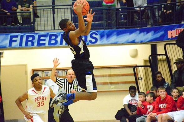 Devon Perry soars as he controls the ball at Tuesday evenings Bulldog 61–43 victory over Lima Perry. (Photo by Daniel Deaton)