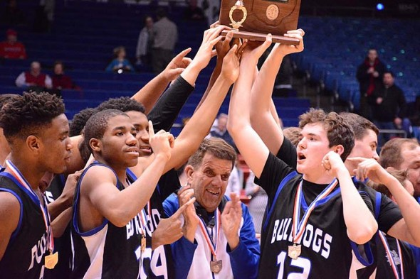 The Bulldog boys' basketball team exulted over their decisive win (66–24) against Middletown Christian last week in the last game of the District IV finals. From left, Joe Plumer, Devon Perry, Team Manager Stewart Miller and Ethan Dewine held up the championship plaque. On Tuesday, March 8, the brand-new District IV Champs won the semi-final game against Lima Perry in the regional tournament and they go on to the regional finals this Friday, March 11, at 7 p.m. at the Fairmont Trent Arena. See page 12 and visit ysnews.com for details and more photos of the games. (Photo by Daniel Deaton)