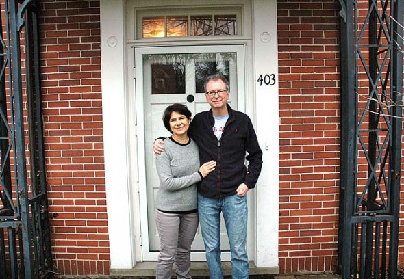 Antioch College's new president, Tom Manley, and his wife, Susanne Hashim, stood outside their new home on Antioch's campus, the Folkmanis House on President Street. Manley started at the college on March 1 with a full schedule of campus and community engagements; Hashim and the couple's 11-year-old daughter, Chedin, will relocate to Yellow Springs in May. (Photo by Audrey Hackett)