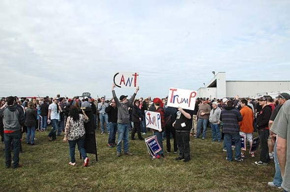 """Supporters of Donald Trump gathered in Vandalia on Saturday to cheer on his bid for presidency. Approximately 10,000 people attended the rally, chanting along with Trump's promise to build a border wall with Mexico and """"bomb the hell out of ISIS."""" (Photo by Dylan Taylor-Lehman)"""