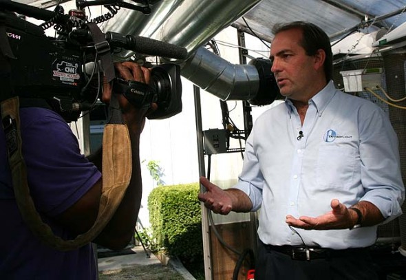 Local company EnviroFlight was recently purchased by Intrexon. Shown above, founder and company president Glen Courtright spoke to a CNN cameraman during a 2013 interview about the company's process for using insect larvae to process bio waste products into fish and animal food.