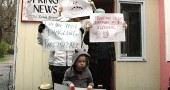 Protestors young and older gather outside the News to voice there complaints about the New's editing policies.