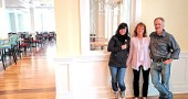The Hammond family—Katie, Libby and Jim—stand in the lobby of the Mills Park Hotel, a project that Jim Hammond started developing in 2012. The hotel will feature a restaurant, banquet hall and gift shop, and is poised to open sometime in late April. Forty people have already been hired to staff the 28-room hotel. (Photo by Dylan Taylor-Lehman)