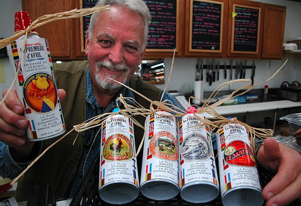 Tom Gray of Tom's displays the initial offerings of Le Premiere d'Avril brand aerosol French cheeses, available later this month at the deli counter.