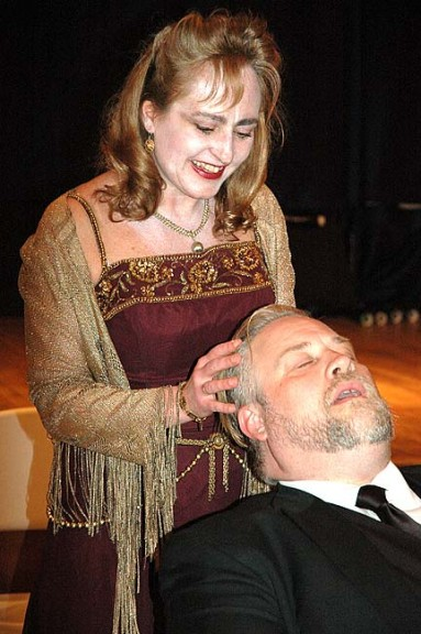 """The ghost of socialite Elvira Condomine (played by Ellen Ballerene) calmed the troubled brow of her remarried husband, Charles (portrayed by Robert Campbell),  in The Yellow Springs Theater Company's new production of Noel Coward's comedy """"Blithe Spirit."""" Performances begin this weekend, April 8–10, and conclude April 15–17 at First Presbyterian Church. Curtain times are 8 p.m. Fridays and Saturdays and 2 p.m. Sundays. (Photo by Carol Simmons)"""