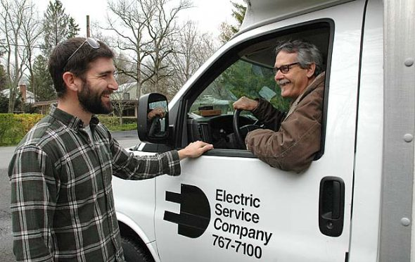 Paul Larkowski, left, shared a laugh with longtime village electrician Larry Gerthoffer, better known as Larry Electric. Gerthoffer has been wiring village homes and businesses for over 40 years. Larkowski, who is working toward his contractor's license under Gerthoffer, hopes to continue his mentor's 'lectric legacy in Yellow Springs. (Photo by Audrey Hackett)