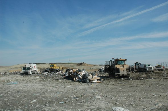 Heavy equipment fills and flattens the approximately 6,000 tons of daily garbage on the Rumpke landfill in Colerain Twp. Much of the machinery is powered by the methane gas recovered from decomposition of the garbage. (Photo by Dylan Taylor-Lehman)