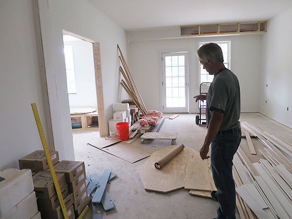 Jim Hammond gives a tour of a suite under construction