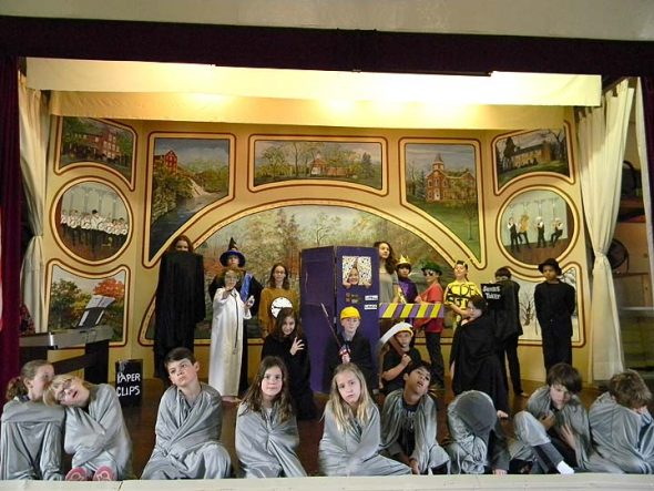 """The Antioch School will perform """"The Phantom Tollbooth"""" this weekend at the Clifton Opera House. The cast is pictured in just some of the costumes they'll wear: up front are the sluggish Lethargarians; behind them are demons, number miners, King Azaz and his advisors, the Mathemagician, the Spelling Bee, Dr. Cacophonous A. Dischord, the Senses Taker, Milo, Tock and the Tollbooth itself. (Photo by Lauren Shows)"""