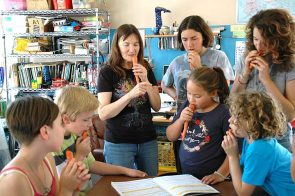 Antioch School Older Group teacher Chris Powell retired last May after 28 years at the school. This photo shows Powell and students making carrot whistles in September, 2015. (News Archive Photo by Carol Simmons)