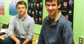 "2016 YSHS salutatorian Henry Potts-Rubin, left, and valedictorian Gabriel Day sat in front of posters of their favorite subject, math. The two have a broad range of interests, spanning scholarship, sports and art, and both express an immense love of learning for the sake of learning. School counselor Dave Smith said the two are representative of a remarkable senior class, and one that is made up of ""hardworking and lovely people."" (Photo by Dylan Taylor-Lehman)"