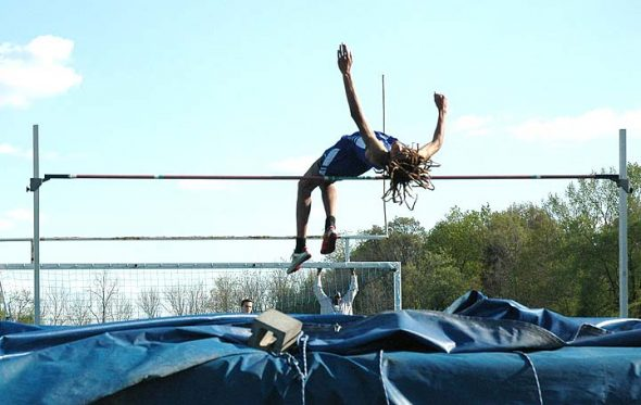 """YSHS Bulldog Oluka Okia leapt an outrageous and record-making 6'6"""" in the high jump event at the Bulldog Invitational track and field meet last week. The Bulldogs' performance included the shattering of many meet records, including a record held for over 20 years. (Photo by Dylan Taylor-Lehman)"""