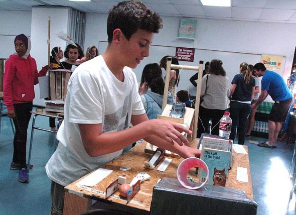 Seventh-grader Sam Lewis tackled the task of cooking an egg in as many complicated steps as possible via a self-designed Rube Goldberg contraption Friday, May 13. To wit, the egg drop seemed to be one domino short of success. (Photos by Matt Minde)