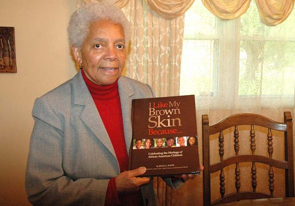 """Villager Julia Davis, former Yelliow Springs High School history teacher, recently published her new book, """"I Like My Brown Skin Because... Celebrating the Heritage of African American Children."""" (Photo by Carol Simmons)"""