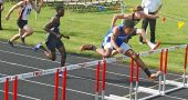 Kaner Butler hurdles to a second-place finish in the 110 hurdles during the regional meet held in Troy last week. Both Okia and Butler, along with Julie Roberts advanced to the state track meet this weekend in Columbus. (Submitted photo)