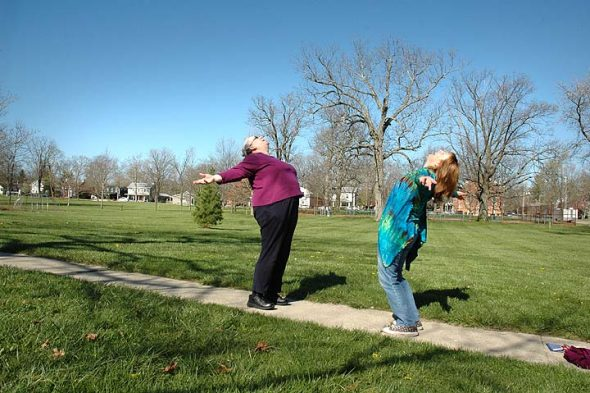 Linda Griffith and Beth Lackey performed laughing yoga earlier this spring. (Photo by Audrey Hackett)