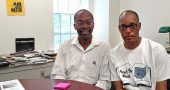 "Antioch Professor of History Kevin McGruder, left, and Mills Lawn School Counselor John Gudgel, former principal of Yellow Springs High School, helped develop the new brochure, ""Blacks in Yellow Springs,"" highlighting the rich history of African Americans in the village. Undertaken by the 365 Project, the brochure is available at the Yellow Springs Chamber of Commerce, the Train Station and elsewhere in the village. (Photo by Dylan Taylor-Lehman)"
