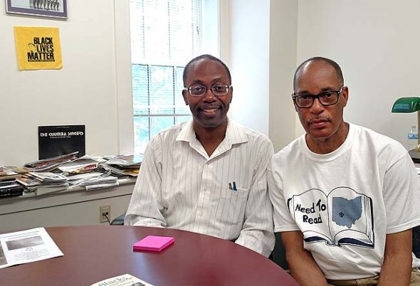 """Antioch Professor of History Kevin McGruder, left, and Mills Lawn School Counselor John Gudgel, former principal of Yellow Springs High School, helped develop the new brochure, """"Blacks in Yellow Springs,"""" highlighting the rich history of African Americans in the village. Undertaken by the 365 Project, the brochure is available at the Yellow Springs Chamber of Commerce, the Train Station and elsewhere in the village. (Photo by Dylan Taylor-Lehman)"""