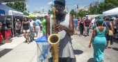 Musician Tumust Allison from Dayton played a powerful sax during last Saturday's Street Fair. (Photo by Aaron Zaremsky)