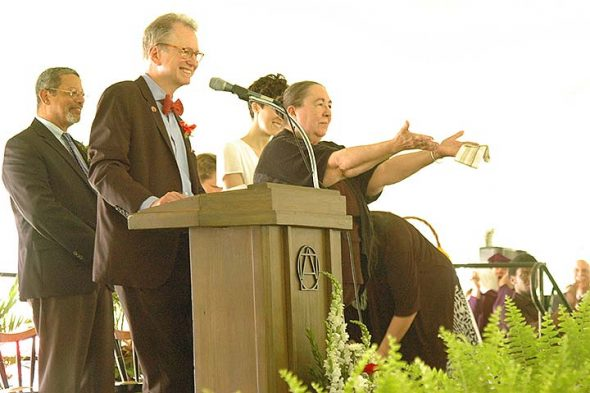 Longtime Antioch College staff member Anna Hogarty will retire at the end of June. Hogarty is shown here at last Saturday's college commencement as she received a standing ovation from students, faculty and community members. At left are interim Enrollment Management Leader Harold Wingood and President Tom Manley. (Photo by Matt Minde)