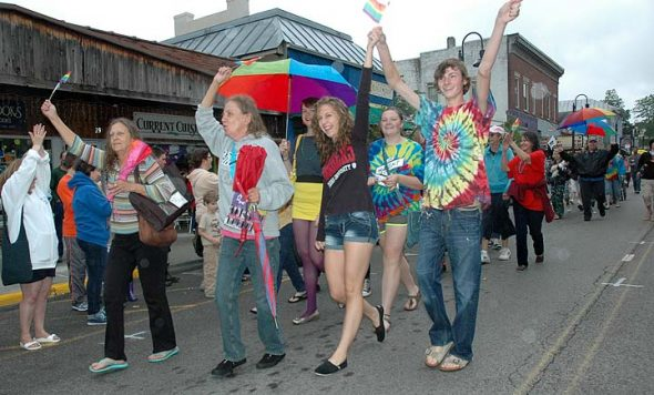 The fifth annual YS Pride Celebration will take place downtown on Saturday, June 25. The day will be packed full of events, such as live music, guest speakers and an interfaith service of affirmation. Dayton-area drag performers, The Rubi Girls, will perform at Peach's. Shown above are revelers from last year's Pride parade, marching proudly in the rain. (News Archive Photo by Diane Chiddister)