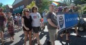 Under a hot summer sun several hundred villagers celebrated diversity and equality Saturday during Yellow Springs Pride events. Shown above at the fifth annual parade are Andi and DeLaine Adkins and Chris Wyatt of Scouts for Equality. (Photo by Diane Chiddister)