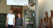 Sam Jacobs and shop owner, Abbey Knight stand in front the newest store downtown, OATS, Ohio Antique Trading Supply. (Photo by Carol Simmons)