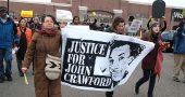 From left, Yellow Springs residents John and Maria Booth and Liz Porter were among the participants in Black Lives Matter protests at the Beavercreek Walmart in December 2014, following the police shooting death of John Crawford III in August. (News Archive photo by Diane Chiddister)