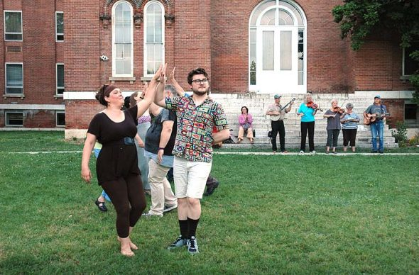 "Miriam Eckenrode Saari and Garrett Young danced to a sprightly fiddle tune (courtesy of the Corndrinkers, in background) during a rehearsal of Shakespeare's ""Much Ado About Nothing"" last week. Performances are free, and will be held outside Antioch Hall (Main Building) on Fridays and Saturdays, July 15–16 and 22–23. Curtain is at 8 p.m. (Photo by Audrey Hackett)"