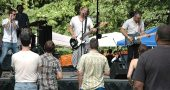 `The first annual Springsfest featured daylong music last Saturday on the lawn in front of the Bryan Center. Bands from the Dayton, Columbus, Yellow Springs and Indianapolis areas performed, including the Motel Beds of Columbus, shown above. (Photo by Diane Chiddsiter)