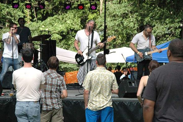 The first annual Springsfest featured daylong music last Saturday on the lawn in front of the Bryan Center. Bands from the Dayton, Columbus, Yellow Springs and Indianapolis areas performed, including the Motel Beds of Columbus, shown above. (Photo by Diane Chiddsiter)