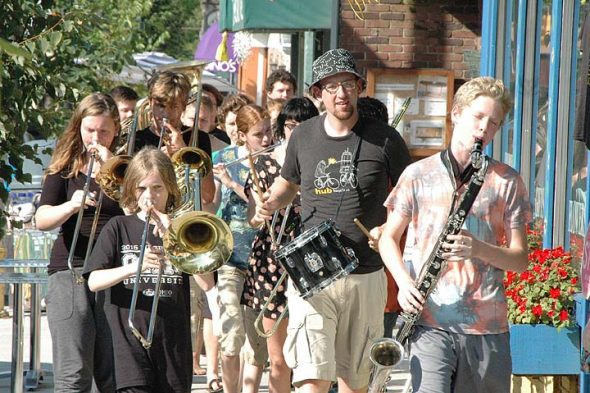 Friends Music Camp campers marched through town to promote their annual concert in 2014. This year's concert is Saturday, July 30, at 7:30 p.m. in the Antioch College Foundry Theater. (News archive photo by Matt Minde)