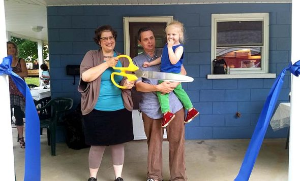 Tanya Maus, James Luckett and their young son, August, celebrated their new Home, Inc. home last Friday, with an open house that included a ribbon-cutting ceremony and potluck. (Submitted photo)
