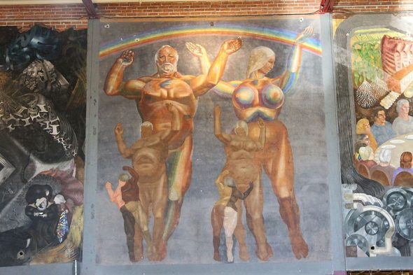 "The center portion of the mural in Antioch College's East Gym, painted by Gilbert Brown Wilson. This section of the mural is entitled ""Man Emerges."" (Photo credit: © User:GabeIglesia / Wikimedia Commons / CC-BY-SA-3.0"