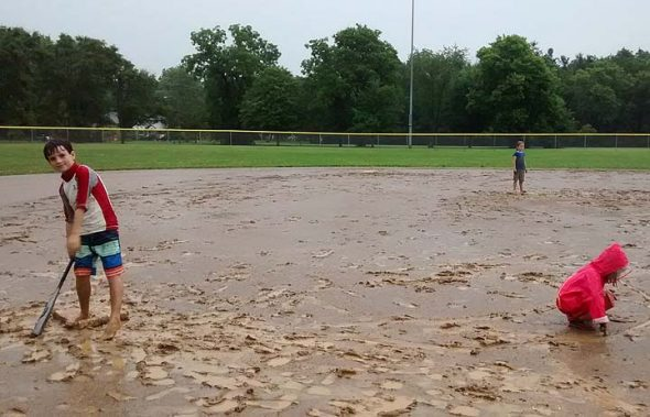 Rain and mud couldn't put a stop to Perry League last Friday, July 29. Seven kids and six adults showed up for a rousing, muddy and wet t-ball time. Shown above are, left, Morgan Gama-Lobo, Marina Gama-Lobo (rear) and Lucy Shows-Fife. (Photo by Lauren Shows)