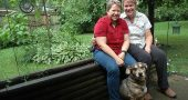 Lori Collins-Hall and Chris Burgher are shown here with their dog, Snickers, in the backyard of their Gardendale Drive home. The two moved to Yellow Springs two years ago from upstate New York after Collins-Hall was offered the job of vice president of academic affairs at Antioch College, where she is now provost. (Photo by Diane Chiddister)