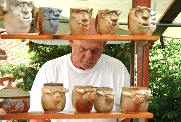 Ceramicist Richard Overman, of Cincinnati, exhibited mugs and other pieces with strong personalities at this year's Art on the Lawn. (Photo by Isaac Delamarte)