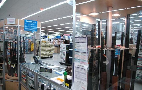 Walmart stores sell their guns behind glass, as pictured above. The Beavercreek Walmart, where John Crawford III was killed two years ago, previously sold air rifles off the shelf, but no longer sells the rifles, according to a store associate. The Xenia Walmart, however, continues to sell air rifles; a recent visit to that store counted 24 varieties of the rifle sold off the shelf. (Photo by Diane Chiddister)