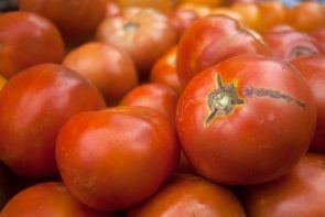Jackson's Farm produces ripe, red tomatoes.