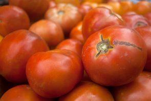 Jackson's Farm produces ripe, red tomatoes.