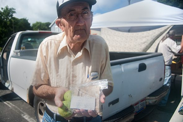 Dan Carter, representing Wyatt's Way, holds up biscuits and fruit at the market. (All photos by Aaron Zaremsky)
