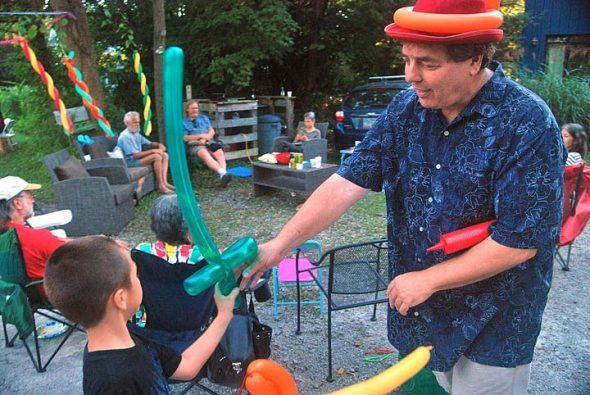 Neighborhood resident and former professional clown Joe Cimoch twisted long, skinny balloons into cats, dogs, hats and swords, to the delight of young and old. (Photos by Aaron Zaremsky)