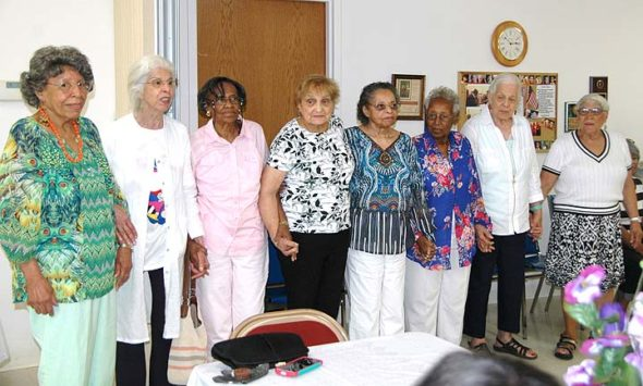A reunion this month of the Victorettes of Yellow Springs — a local service group formed during World War II of young African-American women to support the war effort — brought together eight of the original 17 members, including founder Dorothy Perry Boyce, now 95. From left: Phyllis Lawson Jackson, Anna Hull Johnson, Isabel Adams Newman, Marie Adams Perry Payton, founder Boyce, Dorothy Mundy Allen, Mary Hull Bowers and Betty Cordell Ford. (Photo by Carol Simmons)