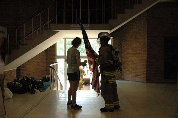 Frederickstown, Ohio, firefighter Jason Bostic and his wife, Jennifer, and son Jonas prepared to exit Antioch College's Main Building on Sunday shortly after completing their 110 flights of stairs. (Photos by Matt Minde)