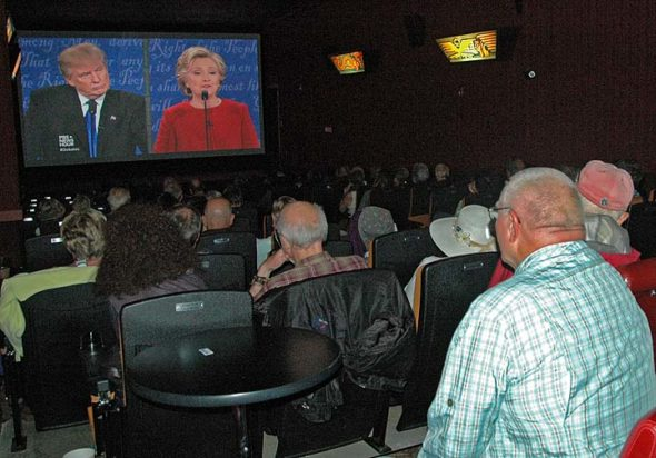 The house was packed Monday night at the Little Art Theatre for a Debate Watch Party presented in partnership with ThinkTV, Channel 16, the local PBS affiliate. Viewers at the free event watched a live stream of the historic presidential debate as it unfolded at Hofstra University in Long Island, N.Y., variously responding to the candidates' pronouncements with jeers or applause. (Photo by Carol Simmons)