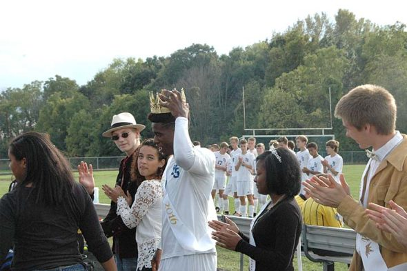 The 2016 Yellow Springs High School homecoming court was feted on Saturday, Oct. 1, just before the boys' home soccer game against Franklin Monroe. Joe Plumer was crowned king; Christina Banks, queen. Pictured here, from left, are Elizabeth Smith (from behind), Aaron Stireman, Shekinah Williams, Joe Plumer, Christina Banks and Peter Day. (Photo by Dylan Taylor-Lehman)